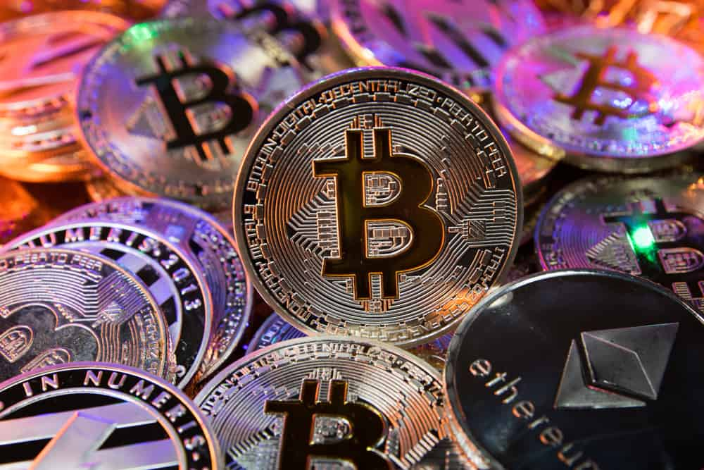 Bitcoin on a pile of cryptocurrency. Source: Shutterstock.com