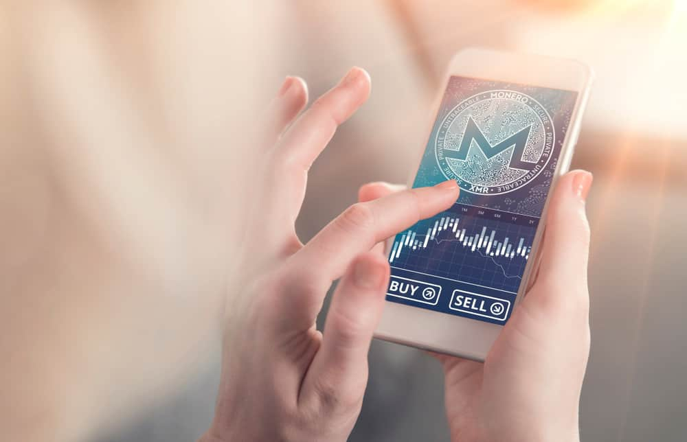 Monero symbol on mobile app screen with big BUY and SELL buttons. Source: Shutterstock.com