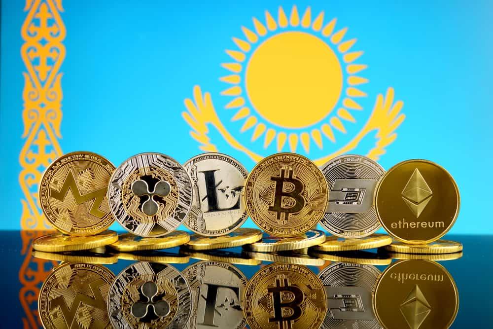 Physical version of Cryptocurrencies (Monero, Ripple, Litecoin, Bitcoin, Dash, Ethereum) and Kazakhstan Flag. Source: Shutterstock.com