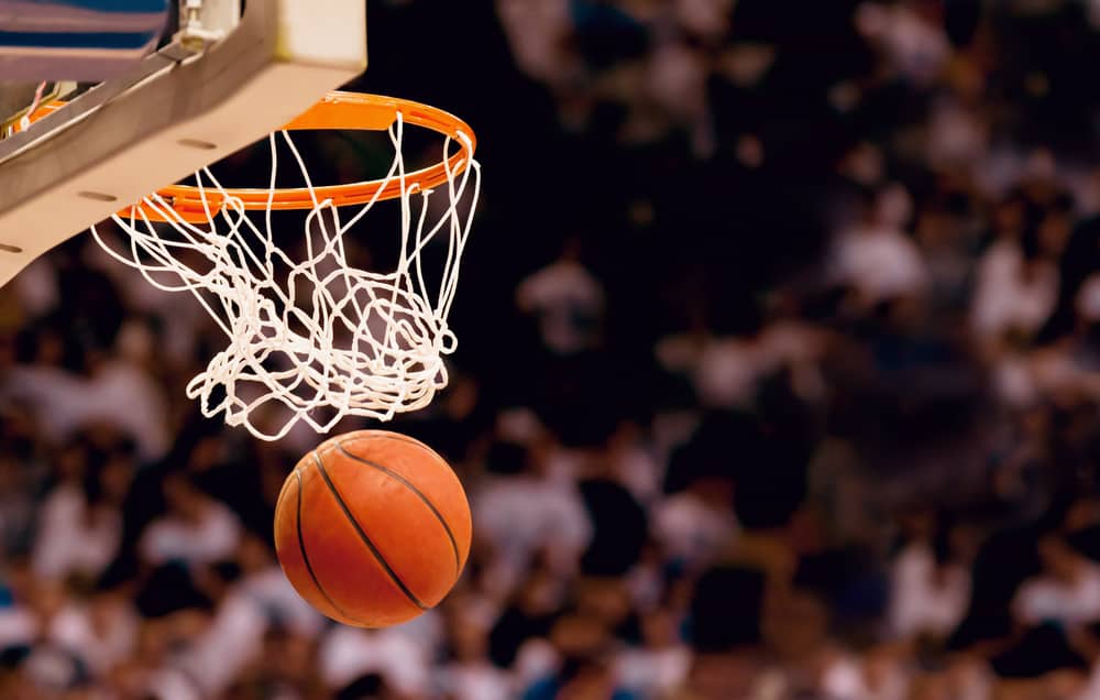 Scoring the winning points at a basketball game. Source: shutterstock.com