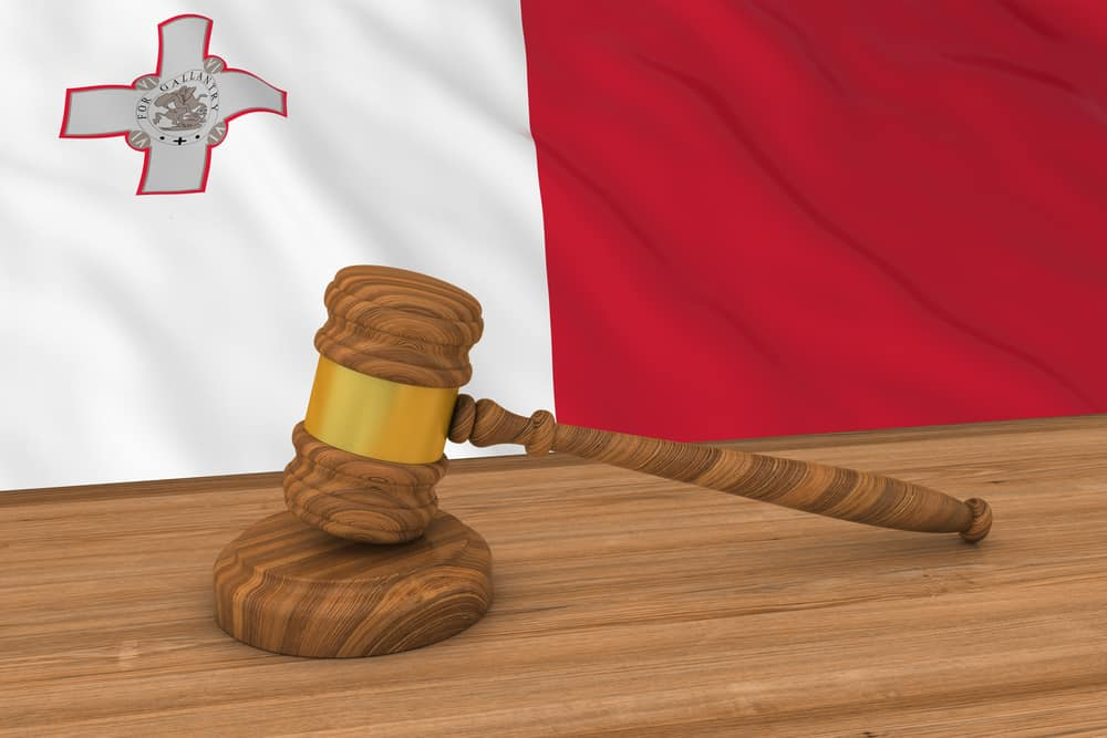 Judge gavel with Malta flag in background. Source: shutterstock.com